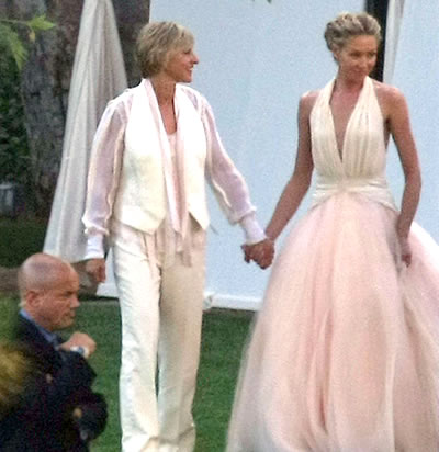 Both brides wore designs by Zac Posen and exchanged rings by Neil Lane amid